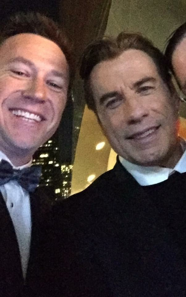 Troy Gray with John Travolta at the Emmy Awards